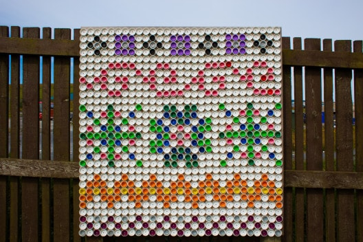 Bottle top Fair Isle art created and donated by a local school