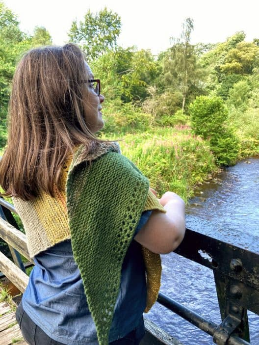 Louise looks over the river at Rosslyn Glen. her Gryer shawl is wrapped around her and over her right shoulder