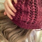 Louise wearing a burgundy lace detail hat